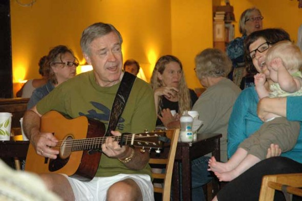 Dave Younkin of the bluegrass band Mad River Railroad took part in a recent Monday morning bluegrass jam at the Emporium. Tanya Maus, with her son August, joined in the singing. (photo by Carol Simmons)