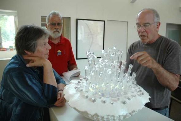 At last year's Art House Hop, Richard Lapedes, one of the hosts, discussed his original sculpture with Jean and Hardy Ballantine. This year's event, a fundraiser for the Yellow Springs Arts Council, will take place on Saturday, Sept. 6, from noon to 5 p.m. (photo by Diane Chiddister)