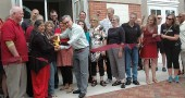 College President Mark Roosevelt cut the ribbon, with the help of Chamber of Commerce President Lisa Goldberg and Village Council President Karen Wintrow, while Mayor Dave Foubert, left, looked on.