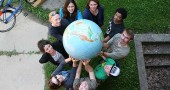 Participants in the recent Antioch College global seminar on water surround the globe because the earth is made up of mostly water. Begining at 12 o'clock going clockwise, Antioch College faculty member Robin Littell, Julian Smith '16, Alex Rolland '17, Sam Stewart '17, Shannon Hart '17, Rian Lawrence '17, faculty member Brooke Bryan, David Schopmeyer '16 and faculty and project leader Flauia Sancier. The community is invited to student presentations this Saturday, Sept. 13, from 9 a.m. to 12:30 at McGregor Hall. (Photo by Suzanne Szempruch)