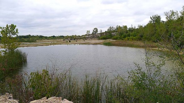 """A former Cemex quarry was turned into a city park, Oakes Quarry Park, which one area resident said """"looks like a meteorite hit it."""" (Photo by Megan Bachman)"""