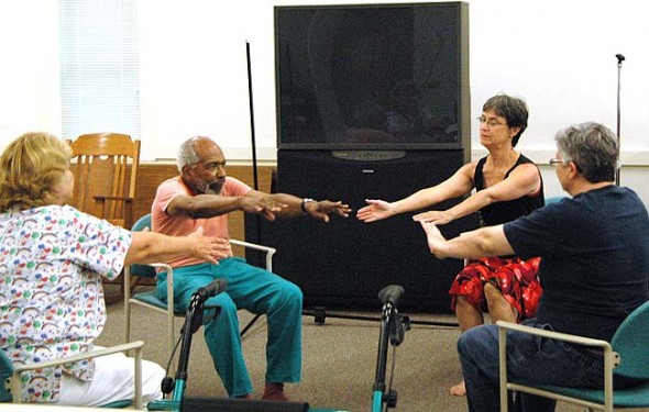Each Wednesday at the Senior Center, dance instructor Jill Becker, third from left, works with Paul Graham, second from left, and Kim Korkan, right, who both suffer from Parkinson's disease, a degenerative disorder of the central nervous system that causes gradual loss of muscular control and can lead to depression and dementia in its advanced stages. A regular regimen of exercise has been shown to strengthen muscles, improve mobility and have a positive effect on mood. (Photo by Jenn Wheeler)
