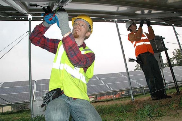 Antioch students David Schopmeyer, left, and Alex Rolland work on the college's new solar array. (Photo by Megan Bachman)