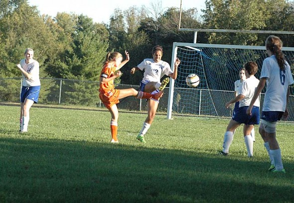 YSHS defender Nekyla Hawkins leaped above a Beavercreek forward to challenge for the ball during a matchup last Tuesday. The Lady Bulldogs maintained a strong defensive front in the first half but ended up losing 5–0. (Photo by Megan Bachman)