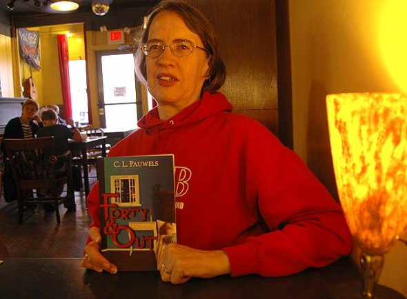 Local crime fiction author Cyndi Pauwels recently released her first fiction book, 'Forty & Out,' through Deadly Writes Publishing. Pauwels will read and sign books at Epic Book Shop at 6:30 p.m. Friday, Oct. 10, and present at the Yellow Springs Community Library at 6:30 p.m. Tuesday, Oct. 14, to kick off National Novel Writing Month. (Photo by Megan Bachman)
