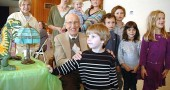Among those celebrating Lloyd Kennedy's 100th birthday last Sunday at the First Presbyterian Church were, in front, Kennedy, Liam Magnus, Mike Trelawny-Cassity, Anaya Adoff and Zan Magnus; in back, from left, Sven Meister, Jane Meister, Kate Meister and Tyler Linkhart. (photo by Carol Simmons)