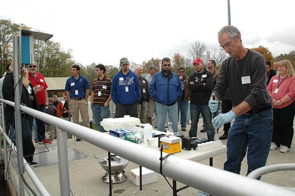 Jon Van Dommelen of the Ohio EPA giving a demonstration at the Yellow Springs wastewater plant on how to troubleshoot nitrification and denitrification with online nitrate and ammonium sensors. (photo by Diane Chiddister)
