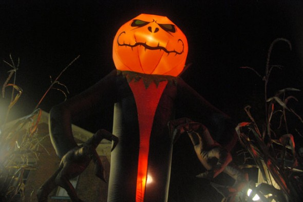 A towering jack-o'-lantern leers at pedestrians from the porch at the Trail Tavern.