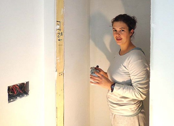 Antioch College Miller Fellow Charlotte Norman helped paint the first Home, Inc. house on Cemetery Street.