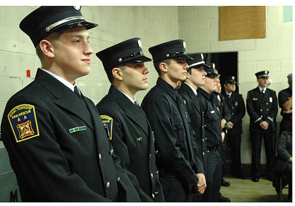 Dressed in formals, new fire fighters await their awards.