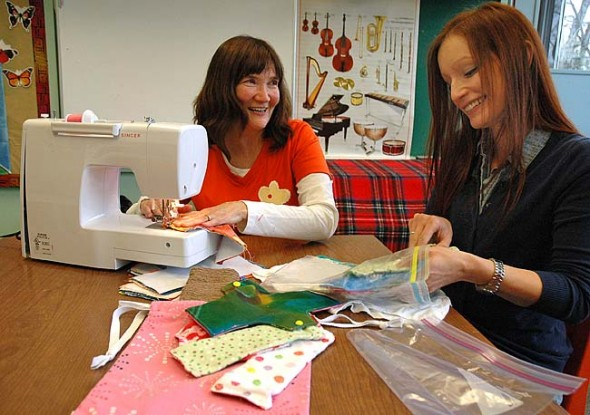 Chris Powell, left, and Ashley Lackovich-Van Gorp are shown sewing mentruation kits for girls in Ethiopia. Powell organized a sewing group to make the kits, sponsored by the nonprofit Days for Girls International, and Lackovich-Van Gorp started Enhance Worldwide, a nonprofit that supports orphaned girls in Ethiopia. (Submitted photo)