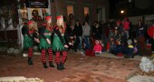 Dancing elves and a tree-lighting event, shown above, kicked off the Yellow Springs holiday season in 2013. This year, a host of events is planned by the Chamber of Commerce, including the Holiday Fest downtown on Saturday, Dec. 13. (News archive photo by Suzanne Szempruch)