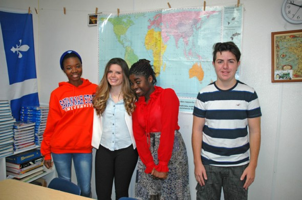 Four American Field Service exchange students are attending Yellow Springs High School this year. Pictured above are, from left, Gigi Niang of Senegal; Julia Cussioli of Brazil; Rina Mac-Lamptey of Ghana; and Andy Soriano Garcia of Italy. (photo by Carol Simmons)