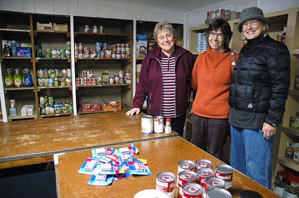 The Yellow Springs Food Pantry, located in the basement of the United Methodist Church, seeks donations for the holiday season. This month the pantry will be open the second Thursday, Dec. 11, and the fourth Tuesday, Dec. 23, from 2 to 4 p.m. Longtime director of the pantry Patty McAllister, left, will step down as director and Paula Hurwitz, center, will take over the first of the year, although McAllister will continue to volunteer at the pantry. Ruth Paige, right, will serve as coordinator of volunteers. (Photo by Diane Chiddister)