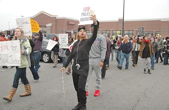 Several hundred people, including many villagers such as Jeanna Breza, at left, attended a protest at Walmart this afternoon to protest the August police shooting of John Crawford at the store. Two people were arrested, including Sandy King of Yellow Springs. (Photo by Diane Chiddister)