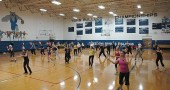 This year's annual Zumbathon fundraiser will take place on Saturday, Jan. 3, from 10 a.m. to noon at the Mills Lawn gym. The event will raise funds for the MLS project-based learning. Shown above is the 2011 fundraiser. (News archive photo by Megan Bachman)