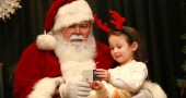 Santa and Mrs. Claus can to the Glen building on Sat. Dec. 13. Nika Nelson, age 4, shared with Santa her wish list this year, a Frozen ice castle and a pink dress. (Photos by Suzanne Szempruch)