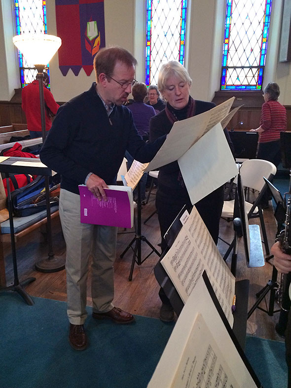 director confers with flutist