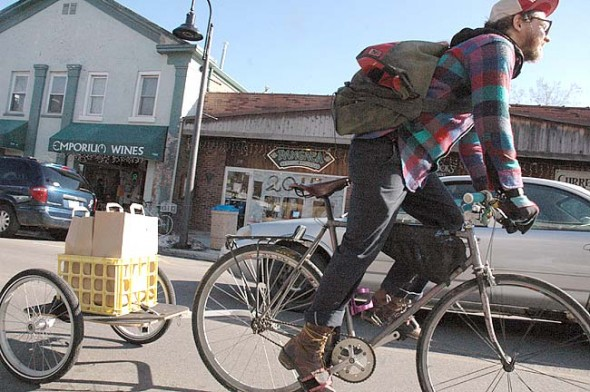 With the new Yellow Springs Delivery Service, Corey Elbin brings by bicycle anything from food orders to grocery items anywhere in the village for $5. (Photo by Megan Bachman)