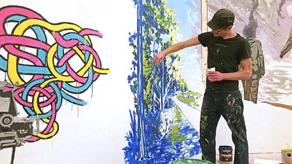 Local artist Travis Tarbox Hotaling is shown working on a mural for the TAG!: Territorial Negotiations exhibit at the Herndon Gallery on the Antioch College campus. The exhibit, which looks at local street art, continues through Feb. 13. (Submitted photo by Odette Chavez-Mayo)