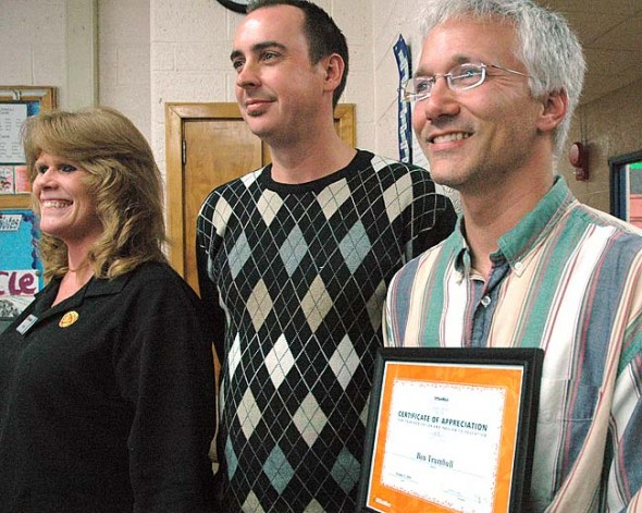 Columbus resident Benjamin Trumbull (right), who teaches at Mills Lawn school, was charged last week by Franklin County police with felony possession of sexually explicit material involving a minor. He is shown here receiving a national teaching award in 2010. (News archive photo by Megan Bachman)