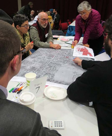 About 200 villagers, including, clockwise from top left, Carmen Milano, Len Kramer and Neenah Ellis, took part in Sunday's opening event at the Antioch College Village Charrette.