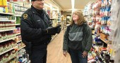 Yellow Springs Police Officer Brian Carlson talked to Brenda Donley at Tom's Market during a recent Tuesday afternoon business rounds drop-in. Village police do a lot of routine patrols and vacant house checks, in addition to responding to calls for service. (Photo by Lauren Heaton )