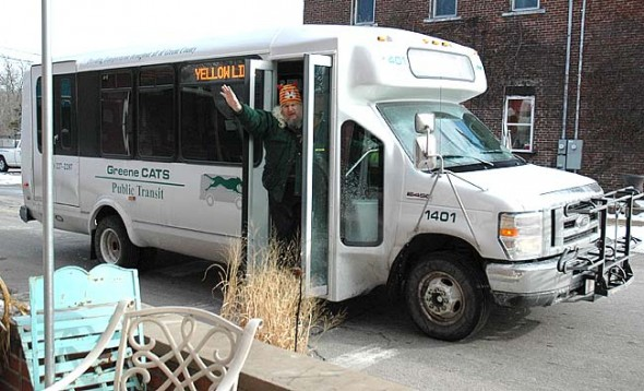 Local resident Gene Lohman is one of about 65 Yellow Springs residents who ride the public bus that comes through the village about every 45 minutes during the weekdays. Anyone interested in a bus route tutorial and free trial ride is invited to sign up now for an event scheduled the week of April 13. The rides are sponsored by the local Climate Change group. (Photo by Lauren Heaton)