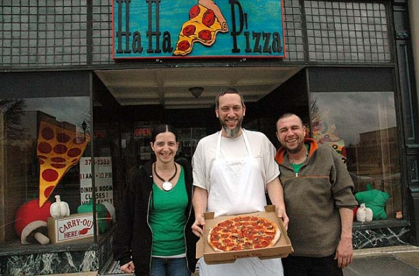 Ha Ha Pizza owner B.J. Walters, center, opened a second restaurant in Xenia last month with help from employees Misty and John Howell.