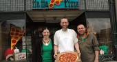 Ha Ha Pizza owner B.J. Walters, center, opened a second location last month on Main Street in Xenia across from the courthouse. The restaurant features the same menu of handmade pizzas, calzones and subs as the original business in Yellow Springs. The move involved a major renovation project facilitated by long-time employees Misty and John Howell. (Photo by Lauren Heaton)