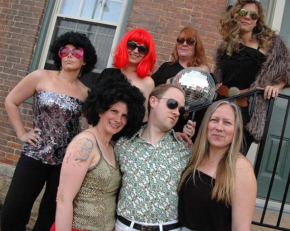 Dressing up in their disco best are, from left, front row, Karla Horvath, Joe Tritschler and Stephanie McClean; back row, Amy Dihrkop, Maggie Cooper, Kira Lugo and Alice Young-Basora. (Photo by Megan Bachman)