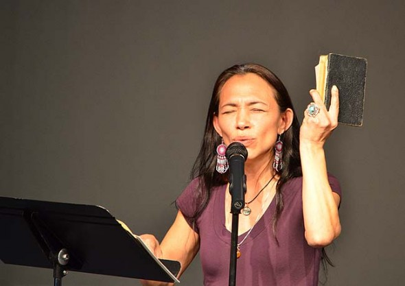 Irene Bedard performing a spoken word piece. (Photo by Megan Bachman)