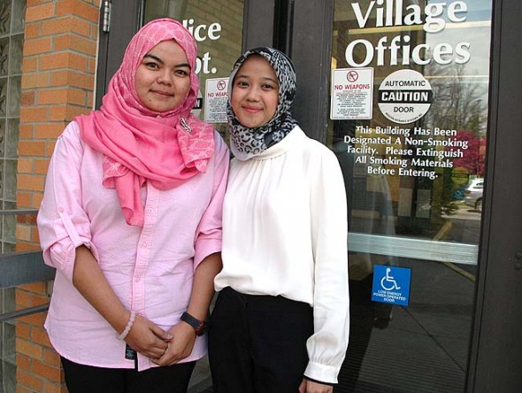 Nadia Jalawi, left, of Malaysia, and Ratih Rahmadanti of Indonesia are young professionals visiting Yellow Springs for a month as part of a cultural and professional exchange sponsored by the U.S. State Department and the International City/County Management Association. While here, they will be helping Village government find ways to engage citizens with social media. (Photo by Diane Chiddister)