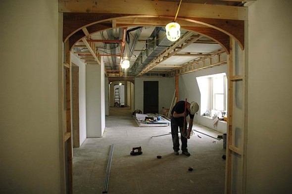 Due to construction delays, the Mills Park Hotel will open in late 2015 instead of the summer as initially planned. The 24,000-square-foot, 28-room hotel is inspired by late 19th-century Southern colonial architecture and the former Mills House that stood across the street. Pictured is a view of the third story interior, which features 12 rooms and a communal sitting area. (Photo by Megan Bachman)