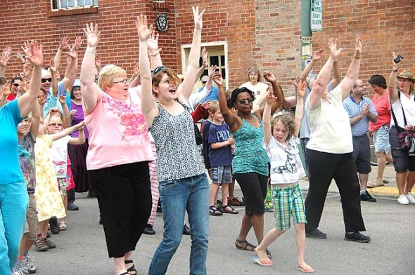 "A second flash mob in as many years will take to Short Street to the tune of ""Shout"" on Wednesday, May 27, at 1 p.m., followed by a party at the Yellow Springs Senior Center. Participants of any age can learn the 2-minute choreographed routine at rehearsals at the Senior Center or online. Last year's flashers danced to ""Heard It Through the Grapevine."" (News Archive Photo by Suzanne Szempruch)"
