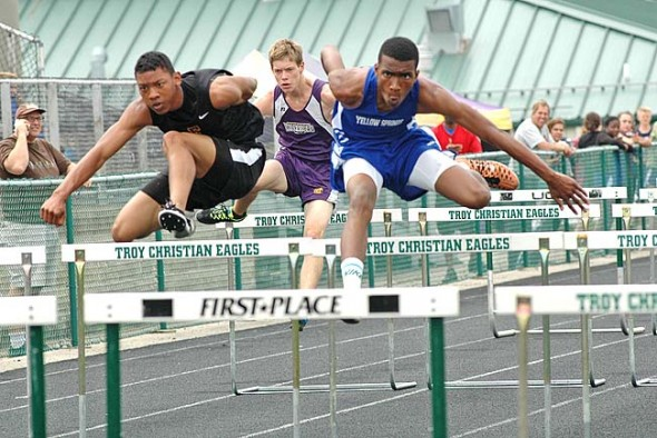 Kaner Butler swept both the 110-meter and the 300-meter hurdles at the Metro Buckeye Conference track and field meet on Saturday, May 16, at Troy Christian, where the Bulldogs finished third and the YSHS girls team took second place. (Photo by Lauren Heaton)