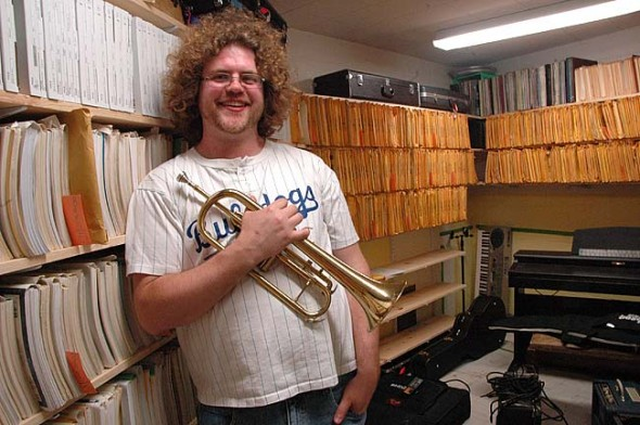 "YSHS Band and orchestra director Brian Mayer used community resources to create a music library, searchable online, in one of the rooms in the ""flying saucer"" at the high school. It's taken him two years, but thousands of band and orchestra scores and pieces can now be found on a database at Mayer's staff page from the high school website.  (Photo by Lauren Heaton)"