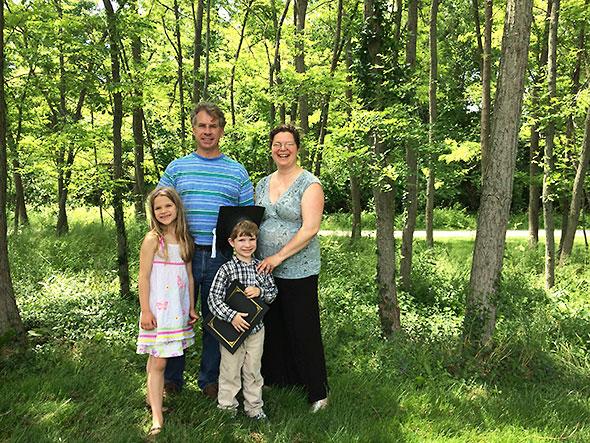 family with preschool graduate