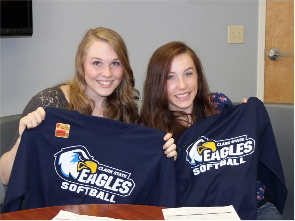 YSHS seniors Jesi Worsham (left) and Chelsea Horton hold up their team shirts after signing to play softball for the 2016 season at Clark State Community College. (Submitted photo)