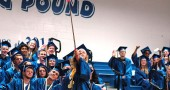 """In her commencement speech last Thursday, May 28, Yellow Springs High School valedictorian Mollye Malone described her bent toward documenting every moment with """"shameless"""" selfies, then telescoped her smart phone for two such records: one of Malone and the Class of 2015 and one of Malone and a gym full of proud families, friends and teachers. (Photo by Lauren Heaton)"""