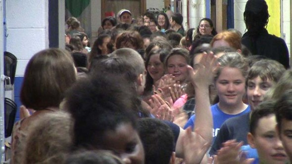 Mills Lawn School sixth grade students run the annual ritual of the clap out. (Video by Matt Minde)