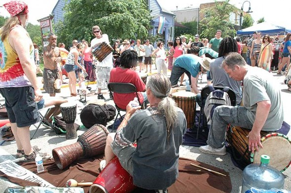 "This year's summer Street Fair featured a come-and-drum happening called the ""Gathering"", at the intersection of Xenia Ave. and Corry St., where passersby were encouraged to grab a rattle, drum, bell, shaker, etc., and play along with the ever-changing groove.  (Photo by Matt Minde)"