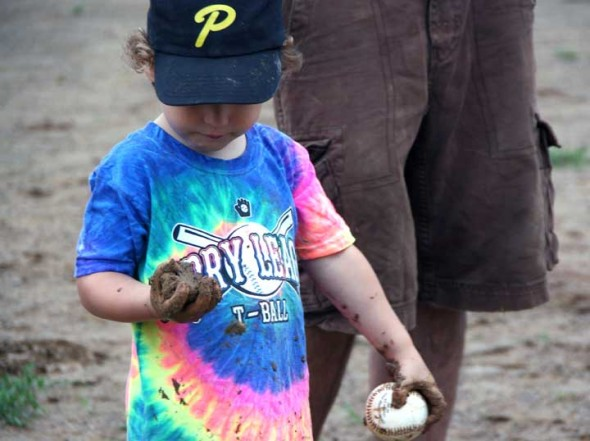 Elliot Craig had a hard time deciding which was more entertaining... playing t-ball or playing in the in mud.