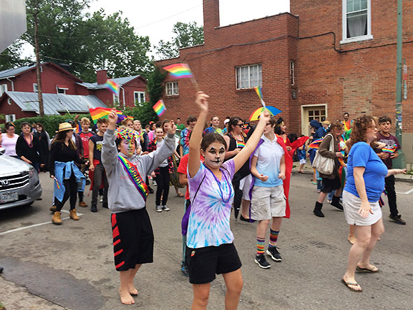 Participants in the pride parade perform the cupid shuffle