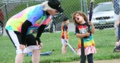 """Jimmy Chesire discusses """"dog, dog, deer. dog, dog,"""" with Maggie Bullock at home base at Friday night's Perry League game. T-ball continues Friday evenings at 6 p.m. through August 7. (Photo by Suzanne Szempruch)"""