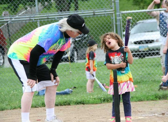 "Jimmy Chesire discusses ""dog, dog, deer. dog, dog,"" with Maggie Bullock at home base at a 2015 Perry League game. (Photo by Suzanne Szempruch)"
