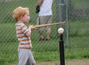Corbin Hyatt puts his own spin on hitting the ball Friday night. (Photo by Suzanne Szempruch)