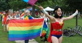 Melissa Heston's Wonder Woman and Mary Kay Smith led last year's Yellow Springs Pride sidewalk parade. Most 2015 Pride events will take place Saturday, with a family potluck at 11:30 a.m. Saturday at John Bryan Center, speakers and music in the afternoon and the parade downtown at 5 p.m. (News archive photo by Megan Bachman)