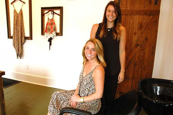 Danyel Mershon, seated, and Emily Anglemyer recently opened Wildflower Boutique and Salon at 232 Xenia Ave., the former home of Iona Boutique. Both women grew up in Springfield but now live in Yellow Springs. Mershon sells women's clothing and jewelry in one section of the store while Anglemyer cuts, styles and colors hair in another. (Photo by Diane chiddister)