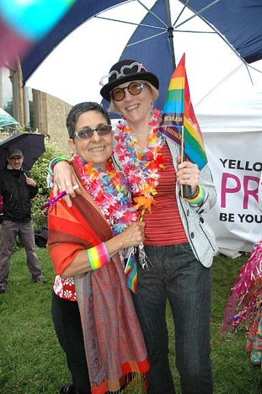 Undeterred by rain and cloudy skies, hundreds of villagers took part in last Saturday's Yellow Springs Pride events, including a downtown sidewalk parade. (Photo by Diane Chiddister)
